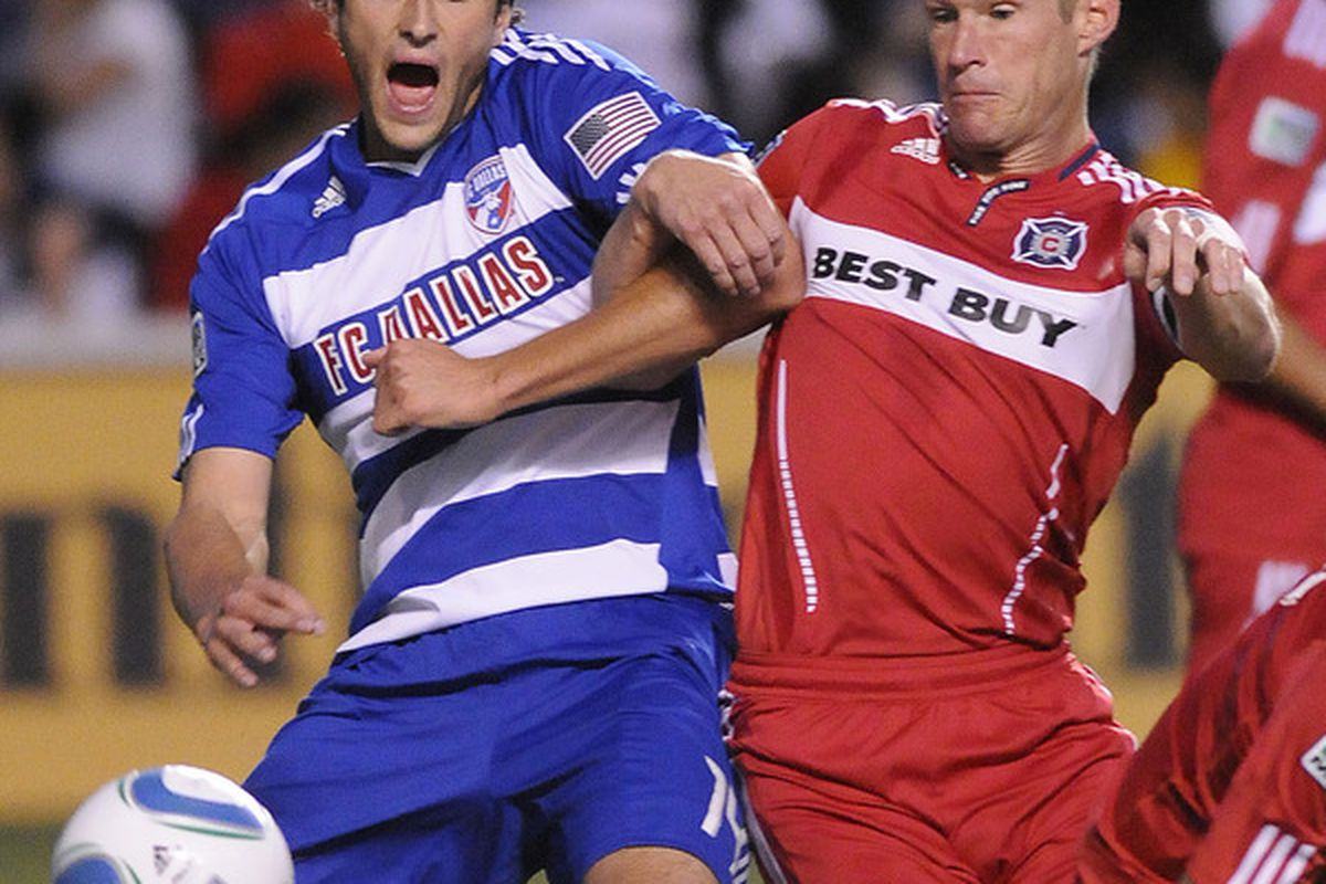 BRIDEVIEW, IL - MAY 27: Brian McBride #20 of the Chicago Fire and  George John #14 of FC Dallas in an MLS match on May 27, 2010 at Toyota Park in Brideview, Illinois. (Photo by David Banks/Getty Images)