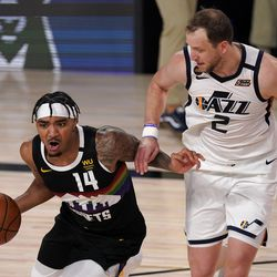 Denver Nuggets' Gary Harris (14) works against Utah Jazz's Joe Ingles (2) during the first half an NBA first round playoff basketball game, Tuesday, Sept. 1, 2020, in Lake Buena Vista, Fla.