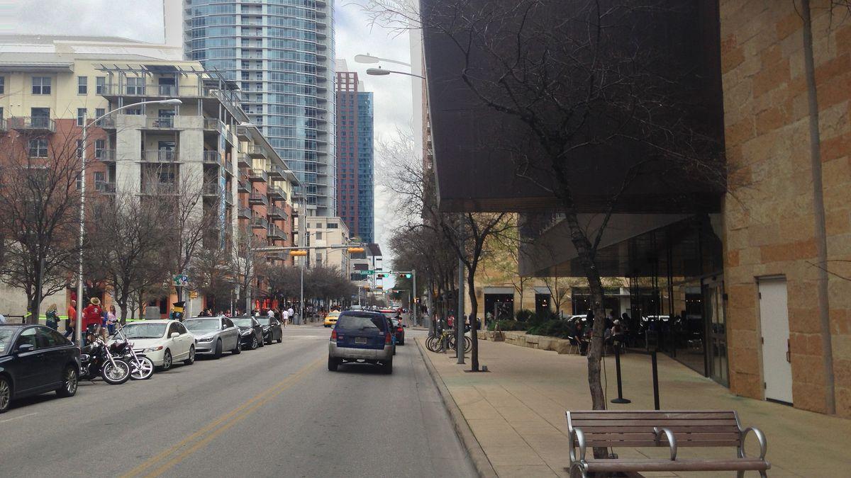 Street between buildings with cars