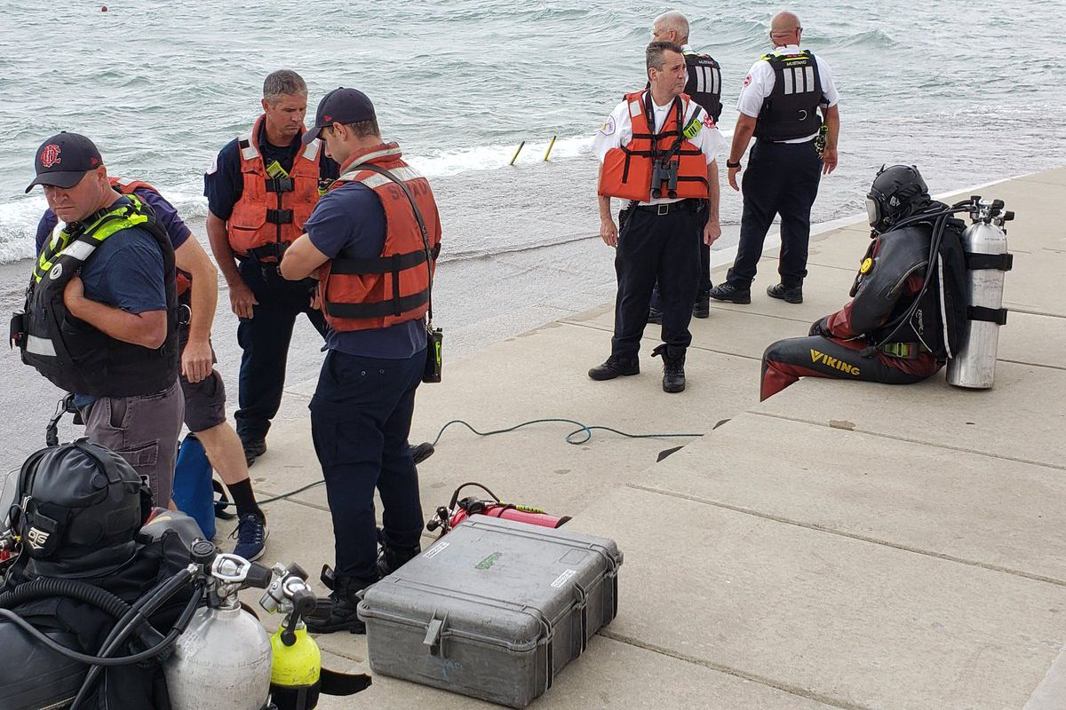 Divers searched for a teen boy who fell into Lake Michigan August 3, 2020, at Diversey Harbor.