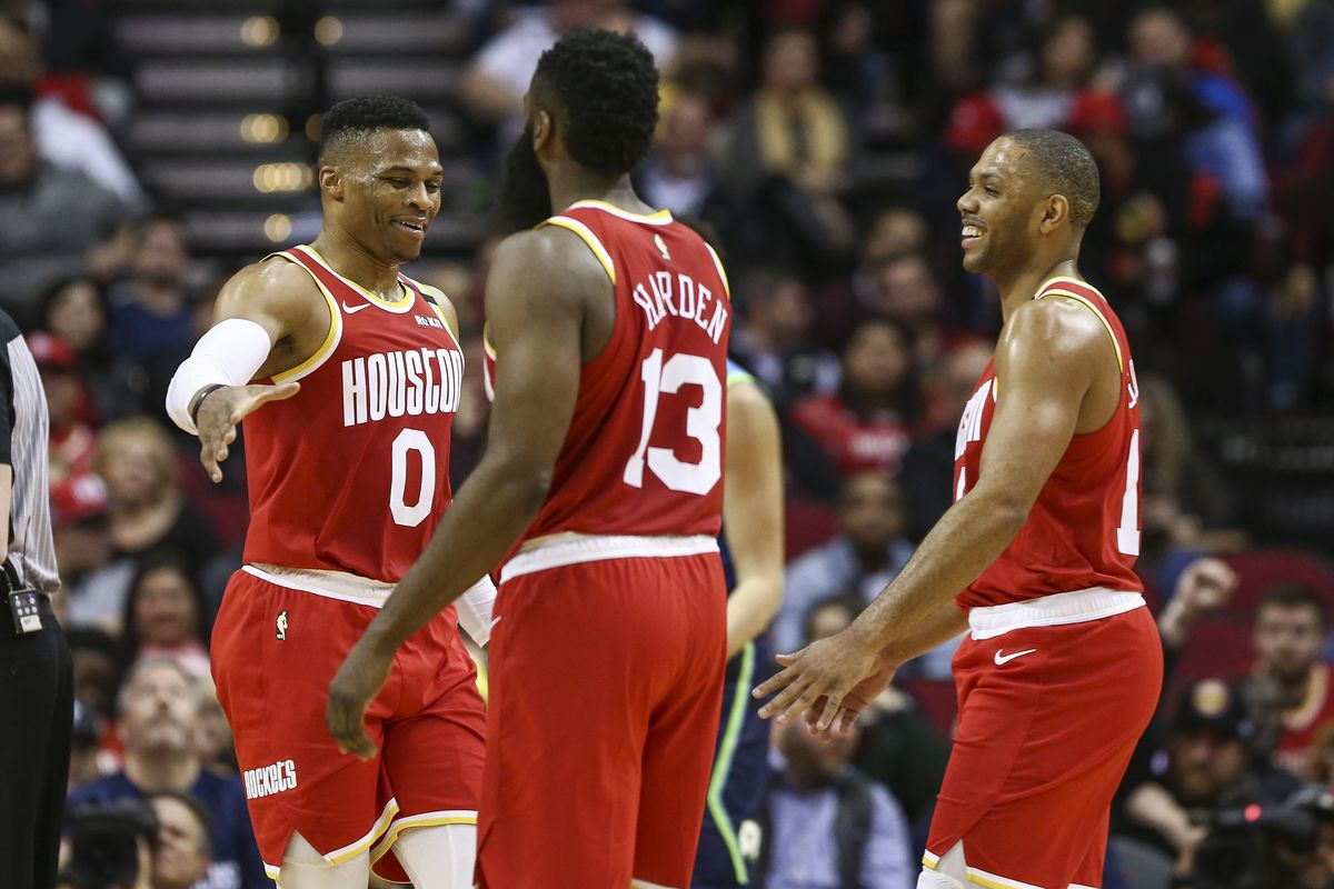 Houston Rockets guard Russell Westbrook shakes hands with guard James Harden and guard Eric Gordon during the second quarter against the Dallas Mavericks at Toyota Center.