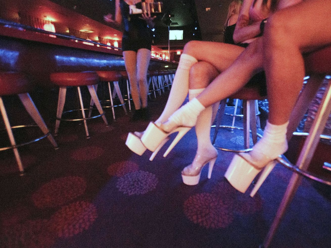 Dancers at Las Vegas clubs like this one, Girls of Glitter Gulch, can soon shed their tops along with some coronavirus restrictions under rules a Nevada COVID-19 task force has approved.