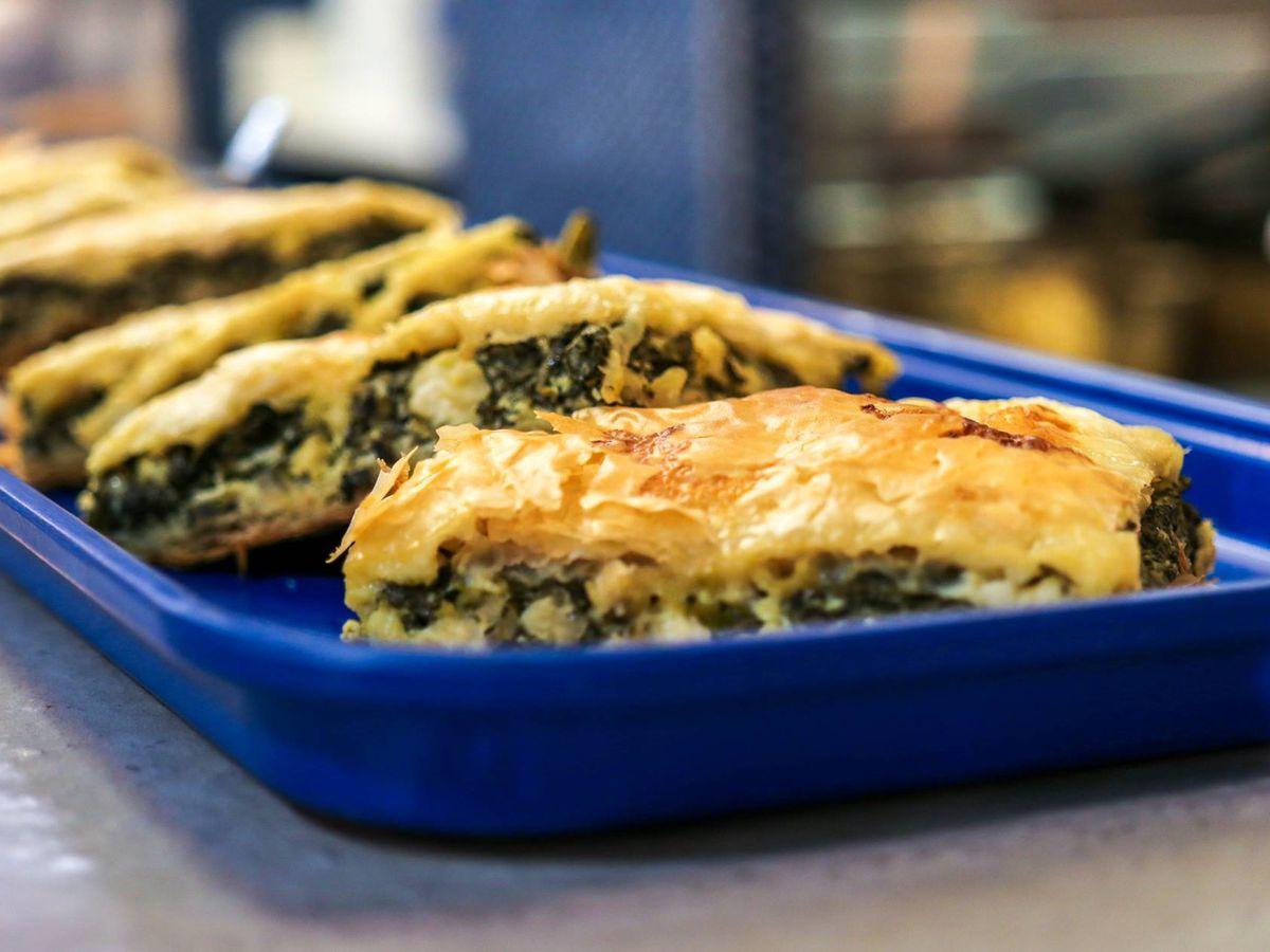greek spinach pie on a blue tray