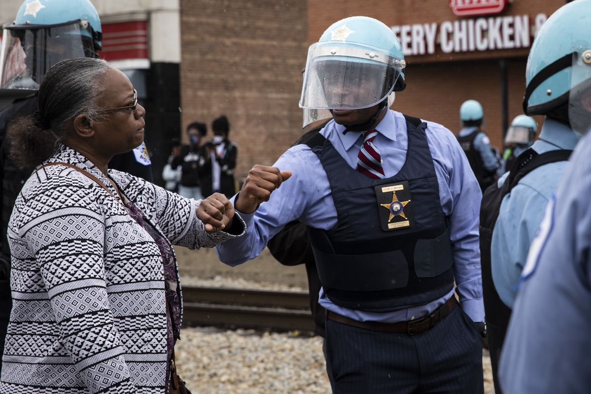 Chicago Police Department Supt. David Brown elbow bumps with Johnnetta Philpotts in South Shore on Monday, June 1, 2020.