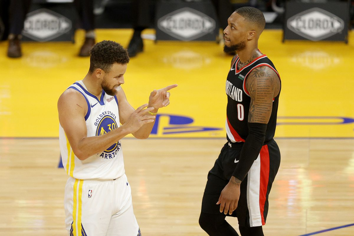 Stephen Curry of the Golden State Warriors reacts in front of Damian Lillard of the Portland Trail Blazers at Chase Center on January 01, 2021 in San Francisco, California.