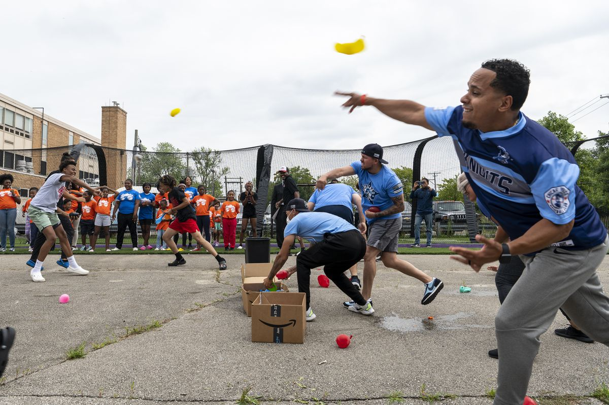 Officers from the Chicago Police Knights Baseball Club held a water balloon fight with West Side Youth, many from The BASE, a youth sports league. The two sides squared off outside the former Marconi Elementary Community Academy on Friday, July 16, 2021.