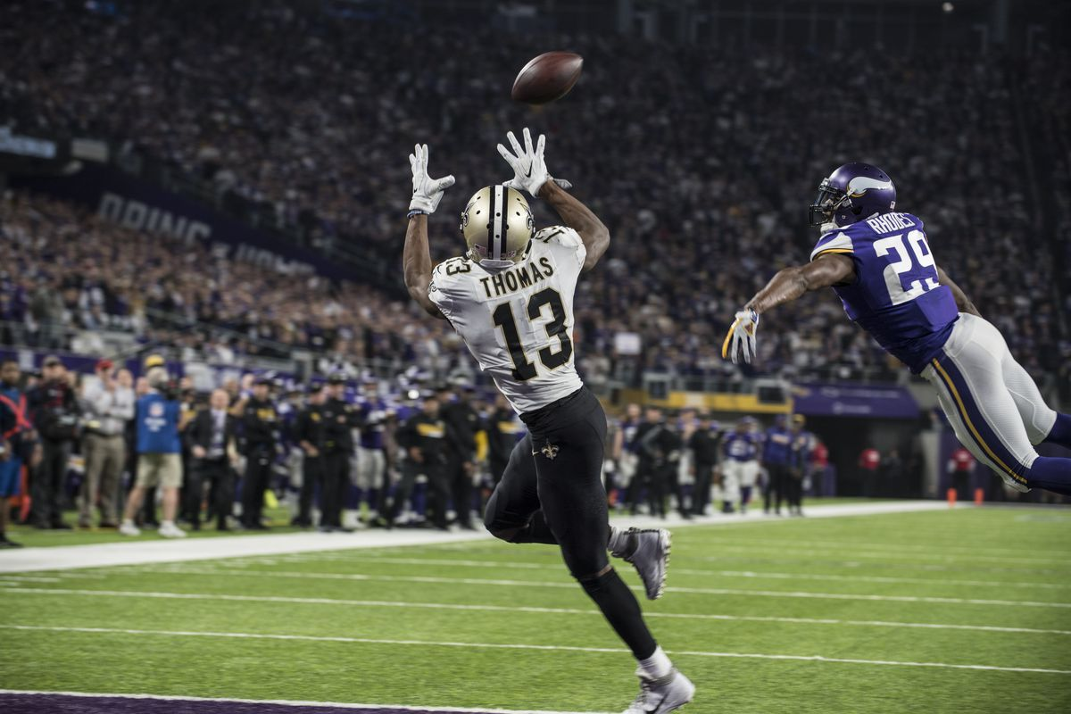MINNEAPOLIS, MN - New Orleans Saints Pro Bowl wide receiver Michael Thomas (13) catches a touchdown from Saints quarterback Drew Brees (not pictured) after torching Minnesota Vikings All-Pro, Pro Bowl cornerback Xavier Rhodes (29) in coverage during the N