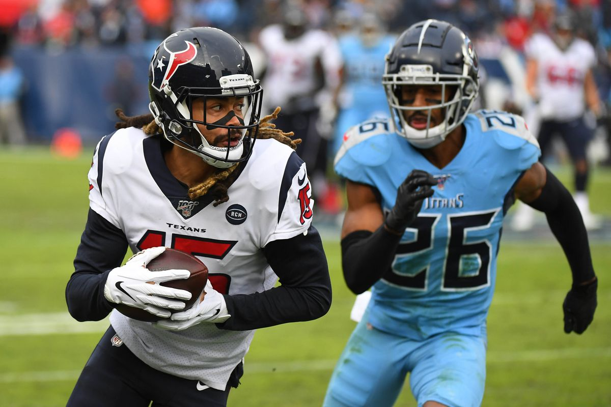 Houston Texans wide receiver Will Fuller catches a pass past coverage fro Tennessee Titans cornerback Logan Ryan during the second half at Nissan Stadium.