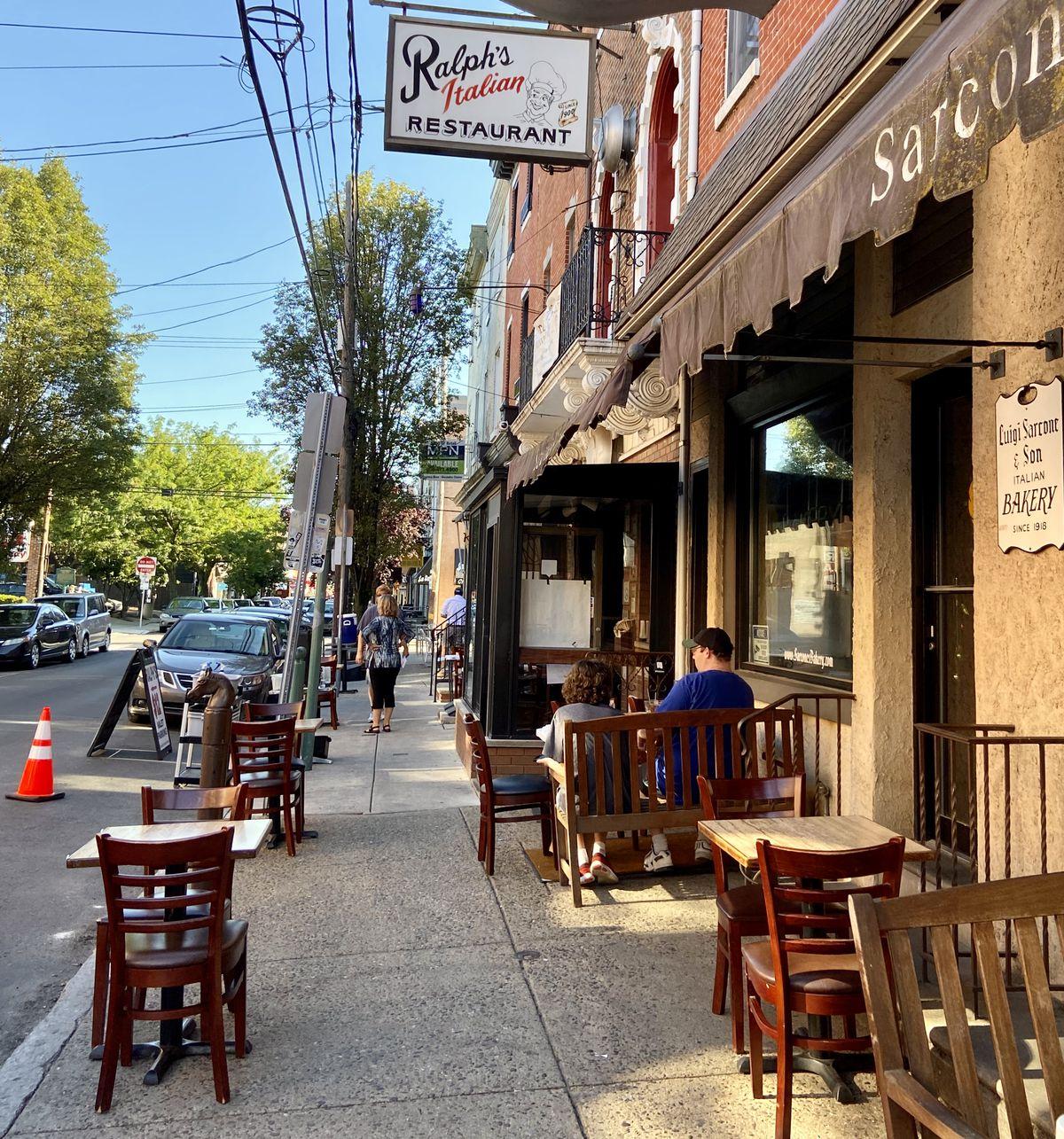 sidewalk seating in front of restaurant