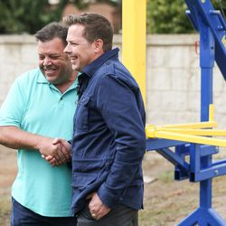 John Renouard, founder and president of WhoLives, and Chris Mattson, professor of mechanical engineering at Brigham Young University, shake hands as they talk to media about the Village Drill at Renouard's home in South Jordan on Friday, Sept. 15, 2017.