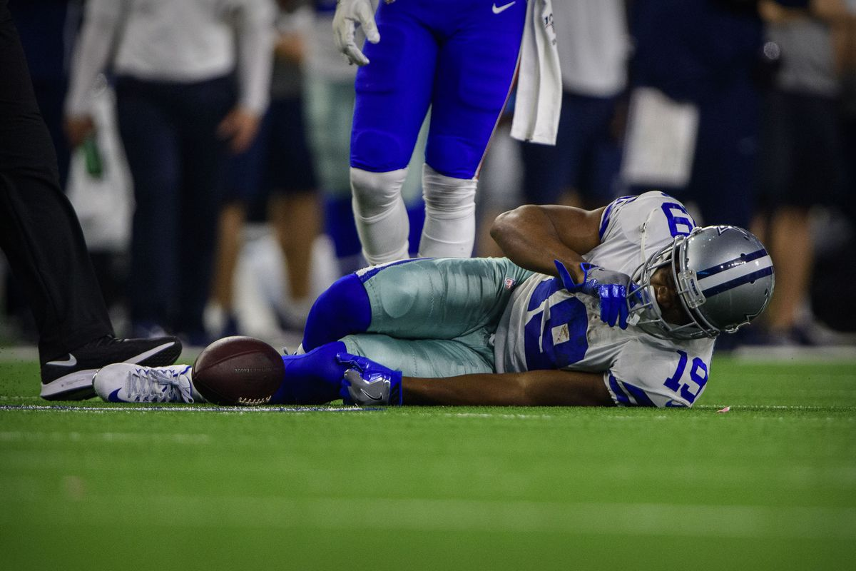 Dallas Cowboys wide receiver Amari Cooper lies on the field with an apparent injury during the game against the Buffalo Bills at AT&T Stadium.