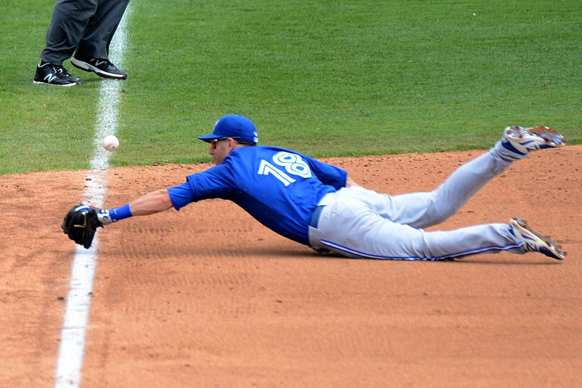 Tolleson diving at a ball.