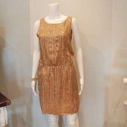With its allover sequins, Calypso St Barth's Editha Dress ($250) provides a glitzy foundation for the first ensemble.