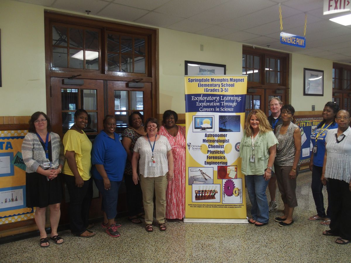 Springdale Elementary School administrators and faculty celebrate after the state Department of Education announces that the Memphis school moved from the state's priority list to its rewards list.