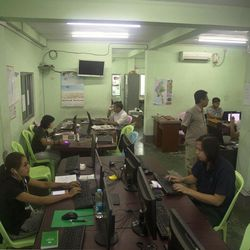 Reporters of The Voice Daily work in their newsroom at its office in Yangon, Myanmar, Monday, June 5, 2017. Police in Myanmar have arrested the newspaper's chief editor and a columnist for allegedly defaming the military by publishing an article mocking its role in the country's efforts to reach a peace agreement with fractious minority groups. A lawyer for The Voice Daily editor Kyaw Min Swe said Monday that the two were not released after being called in for questioning Friday over a lawsuit filed by the military under the country's Telecommunications Law.