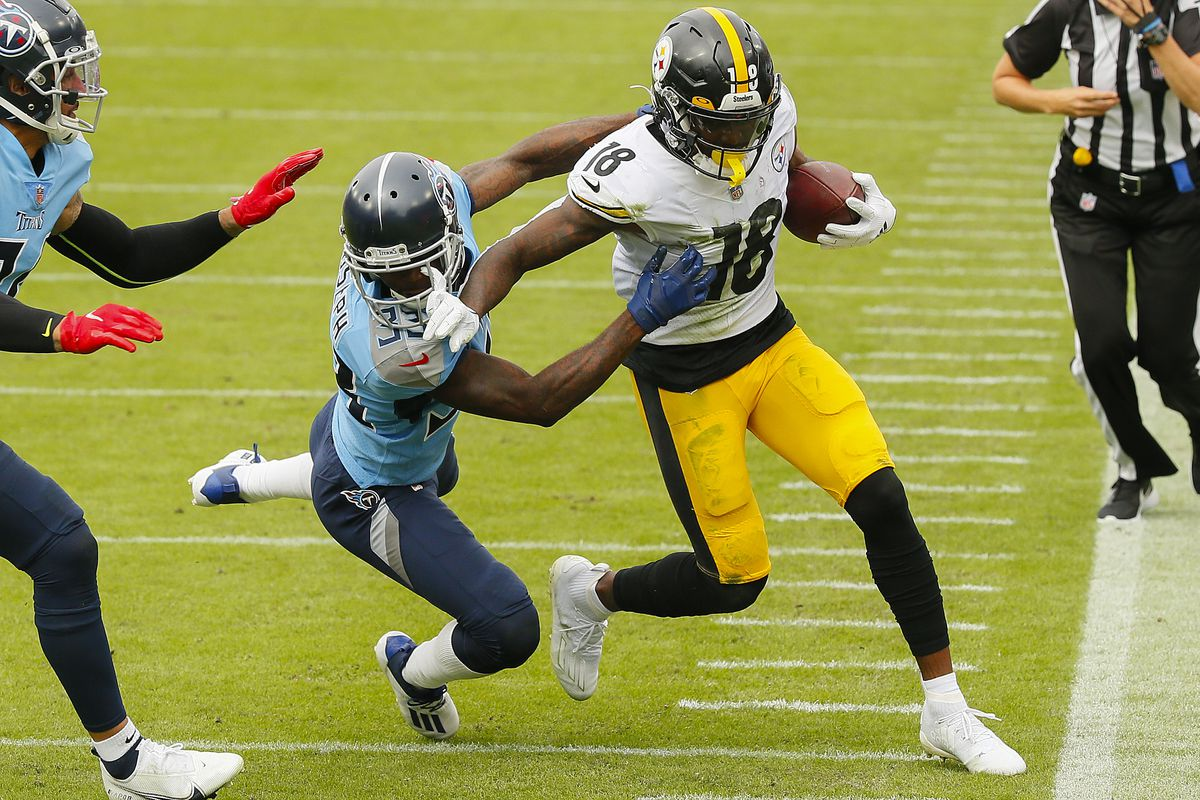 Johnathan Joseph #33 of the Tennessee Titans pushes Diontae Johnson #18 of the Pittsburgh Steelers out of bounds during the first half at Nissan Stadium on October 25, 2020 in Nashville, Tennessee.
