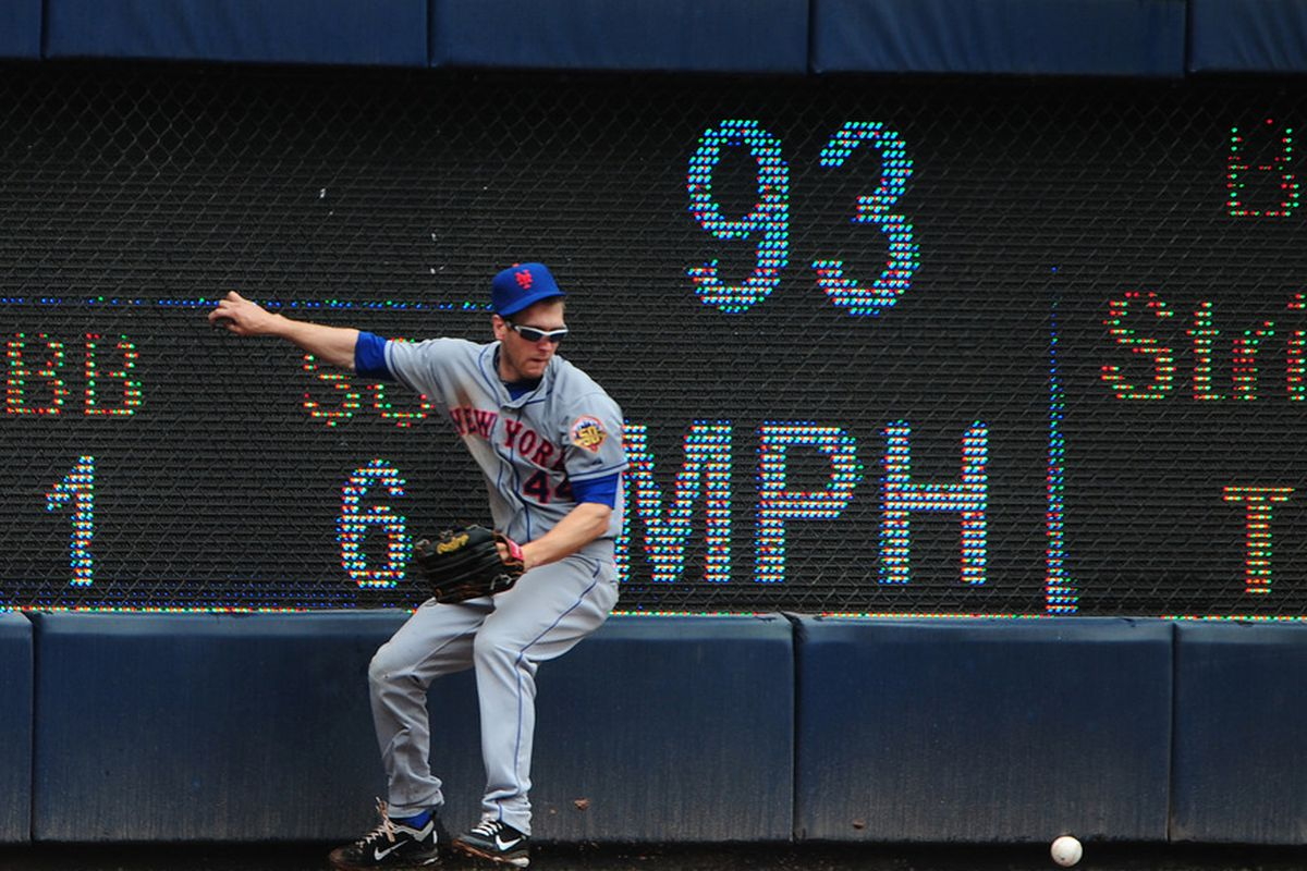 ATLANTA - APRIL 18: Jason Bay #44 of the New York Mets is unable to make a catch against the Atlanta Braves at Turner Field on April 18, 2012 in Atlanta, Georgia. (Photo by Scott Cunningham/Getty Images)