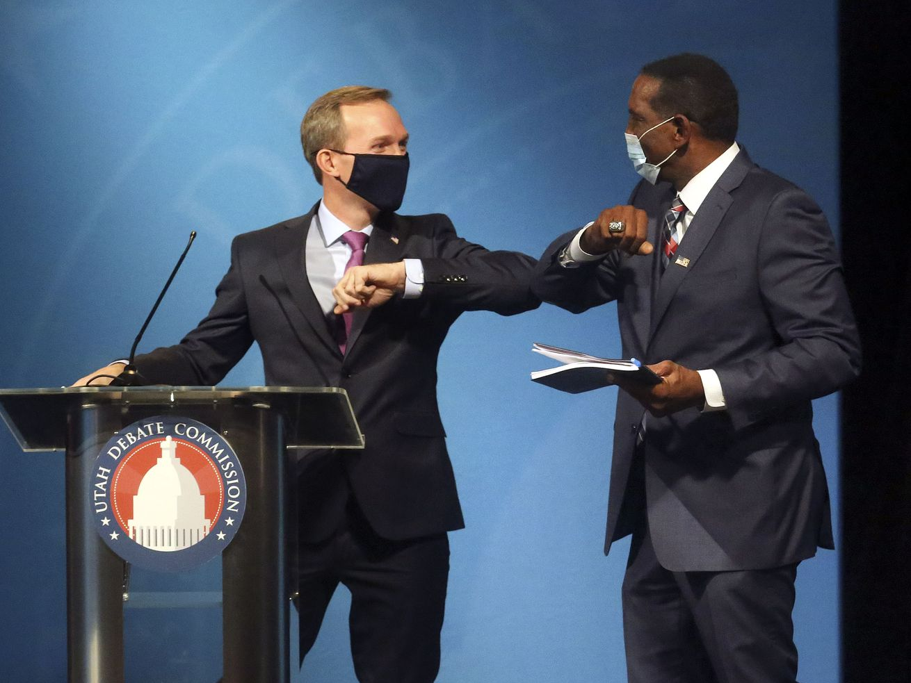 Rep. Ben McAdams, D-Utah, and Burgess Owens bump elbows after participating in the 4th Congressional District debate at the Triad Center in Salt Lake City on Monday, Oct. 12, 2020.
