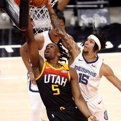 Utah Jazz forward Jarrell Brantley (5) is blocked at the rim by Memphis Grizzlies forward Brandon Clarke (15) as the Utah Jazz and the Memphis Grizzlies play in game 5 at Vivint Arena in Salt Lake City on Wednesday, June 2, 2021. Utah won 126-110, Utah advances to the second round.