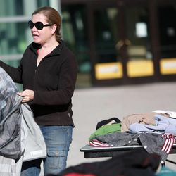 Raphael Cordray folds clothes while volunteering at the Community Coat Exchange in the Salt Lake City Library Plaza in Salt Lake City on Friday, Nov. 29, 2013.