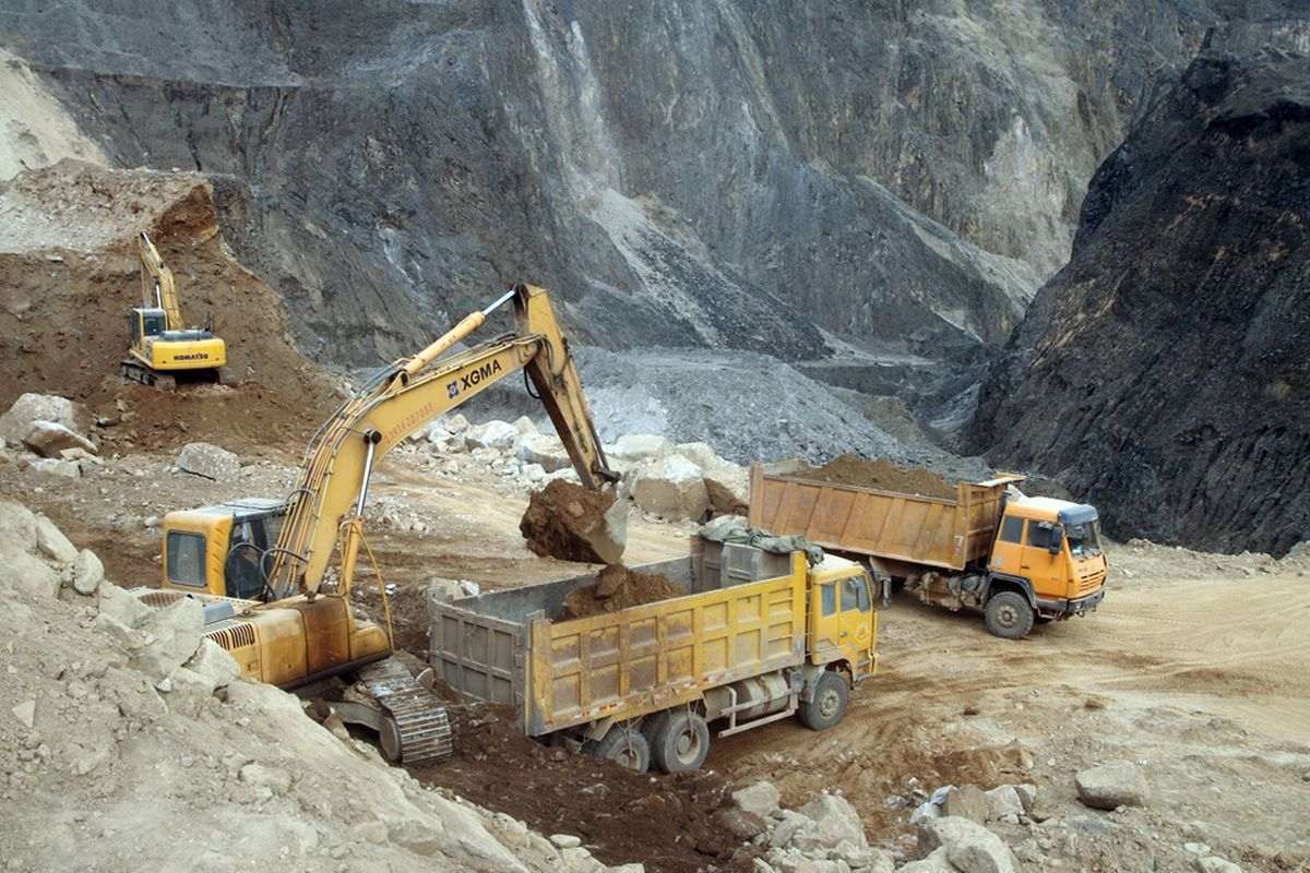 Excavators dig rare earth on a field of Jiangxi Copper Corp's Sichuan branch on February 18, 2011 in Chengdu, Sichuan Province of China.