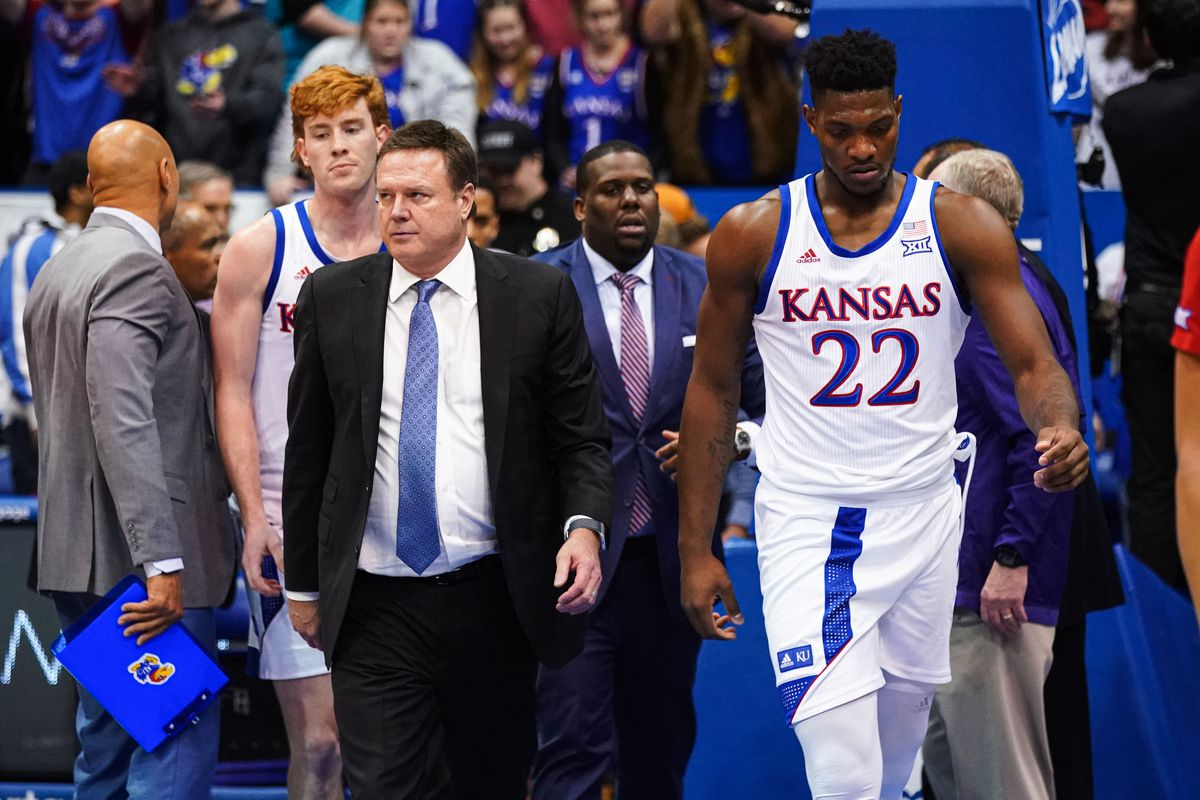 Kansas Jayhawks head coach Bill Self and forward Silvio De Sousa walk off the court after a brawl broke at the end of the game against the Kansas State Wildcats at Allen Fieldhouse.