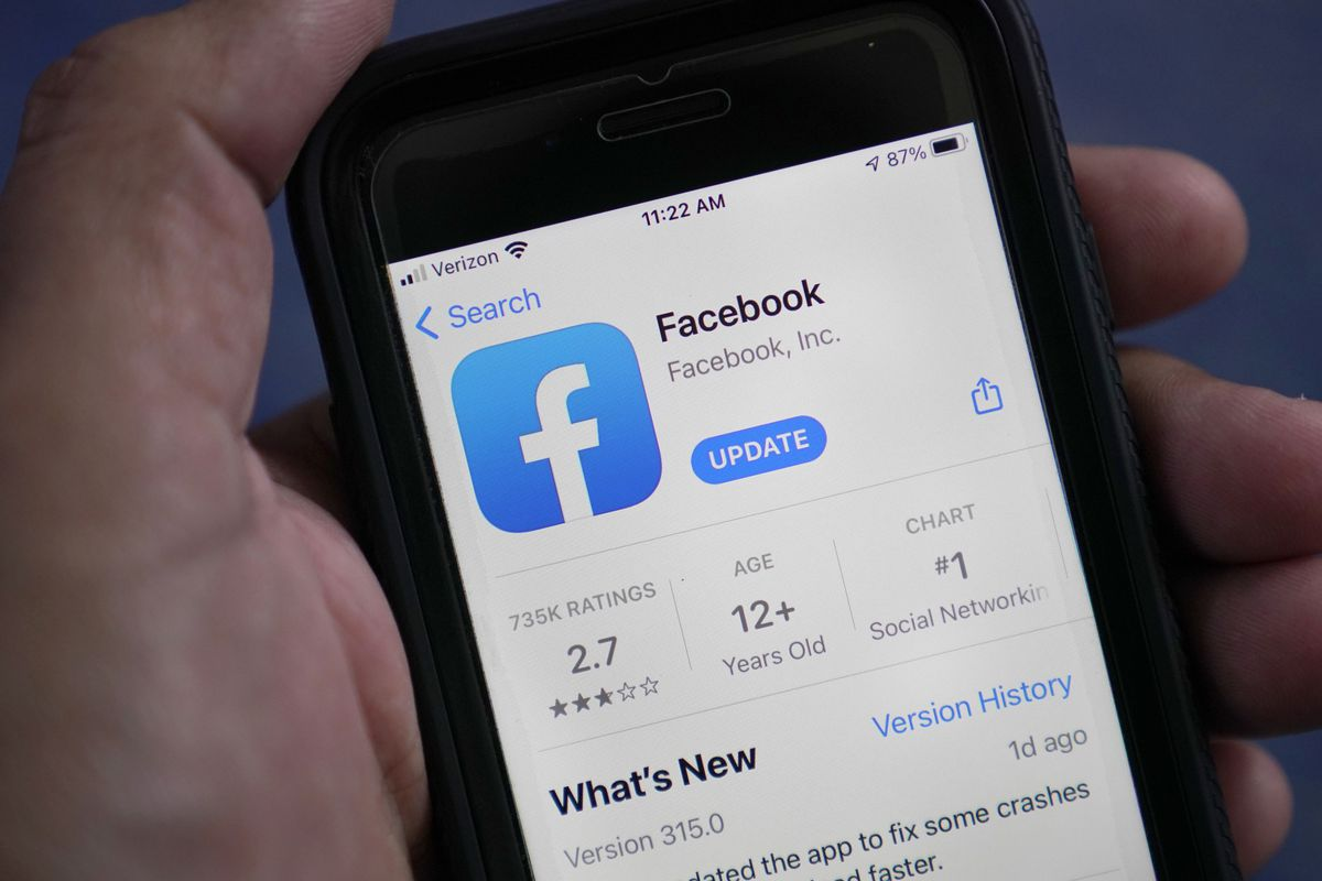 In this file photo dated Friday, April 23, 2021, the Facebook app is shown on a smart phone, in Surfside, USA. European Union regulators said Friday June 4, 2021, they have opened an antitrust investigation into Facebook to look into whether the company distorts competition in the classified advertising market by using data it collects from rival services.