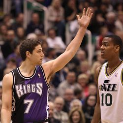 Jimmer Fredette (left) was in Salt Lake City on Monday, Feb. 4, 2013, for the Sacramento Kings' game against the Utah Jazz. Fredette, a former BYU standout, is suing Utah-based clothing company Black Clover Enterprises for allegedly failing to pay him and using his name and likeness for profit.