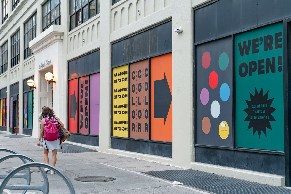 Vacant storefronts at 150 Varick St. in Hudson Square exclaim being open for business on August 31, 2021