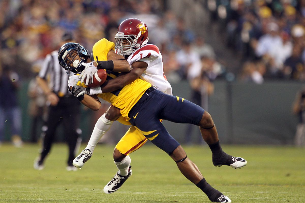 SAN FRANCISCO, CA - OCTOBER 13:  Keenan Allen #21 of the California Golden Bears is tackled by Isiah Wiley #14 of the USC Trojans at AT&T Park on October 13, 2011 in San Francisco, California.  (Photo by Ezra Shaw/Getty Images)