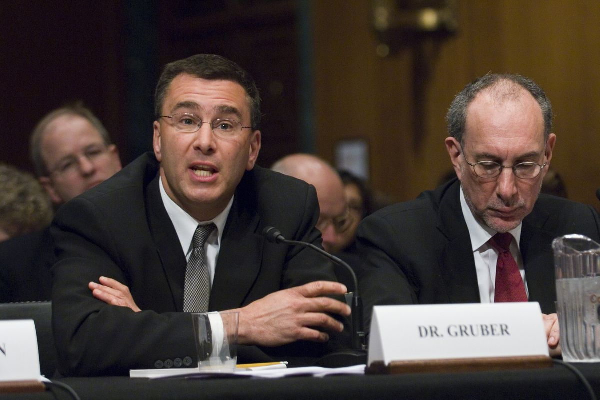 Jonathan Gruber, left, testifies during the Senate Finance roundtable discussion on health reform