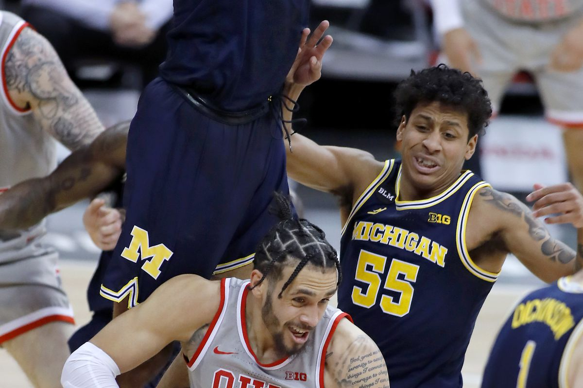 Ohio State Buckeyes guard Duane Washington Jr. is defended by Michigan Wolverines guard Eli Brooks and forward Isaiah Livers during the second half at Value City Arena.