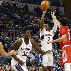 UConn's Alterique Gilbert (3) attempts a three-pointer.