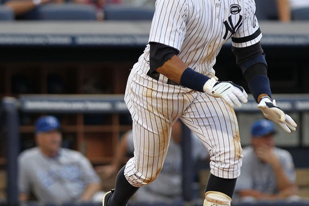 NEW YORK - JULY 22:  Alex Rodriguez #13 of the New York Yankees hits a two RBI double against the Kansas City Royals at Yankee Stadium on July 22 2010 in the Bronx borough of New York City.  (Photo by Nick Laham/Getty Images)