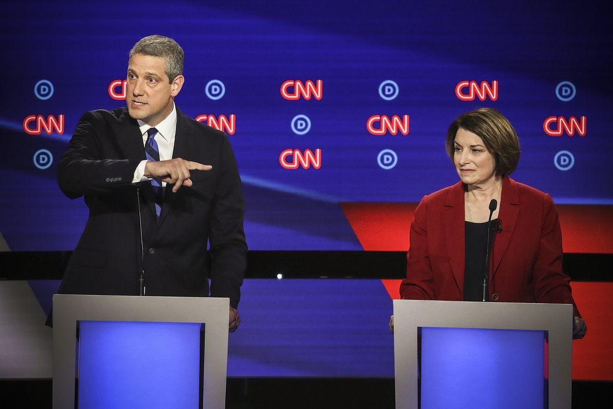 Democratic presidential candidate Rep. Tim Ryan (D-OH) speaks while Sen. Amy Klobuchar (D-MN) listens during the Democratic Presidential Debate on July 30, 2019.