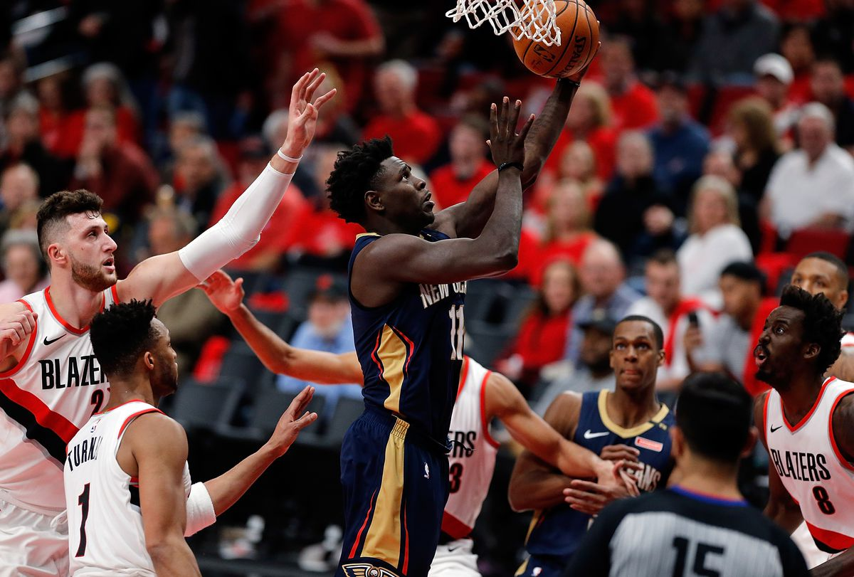 Jrue Holiday drives to the hoop against the Portland Trail Blazers