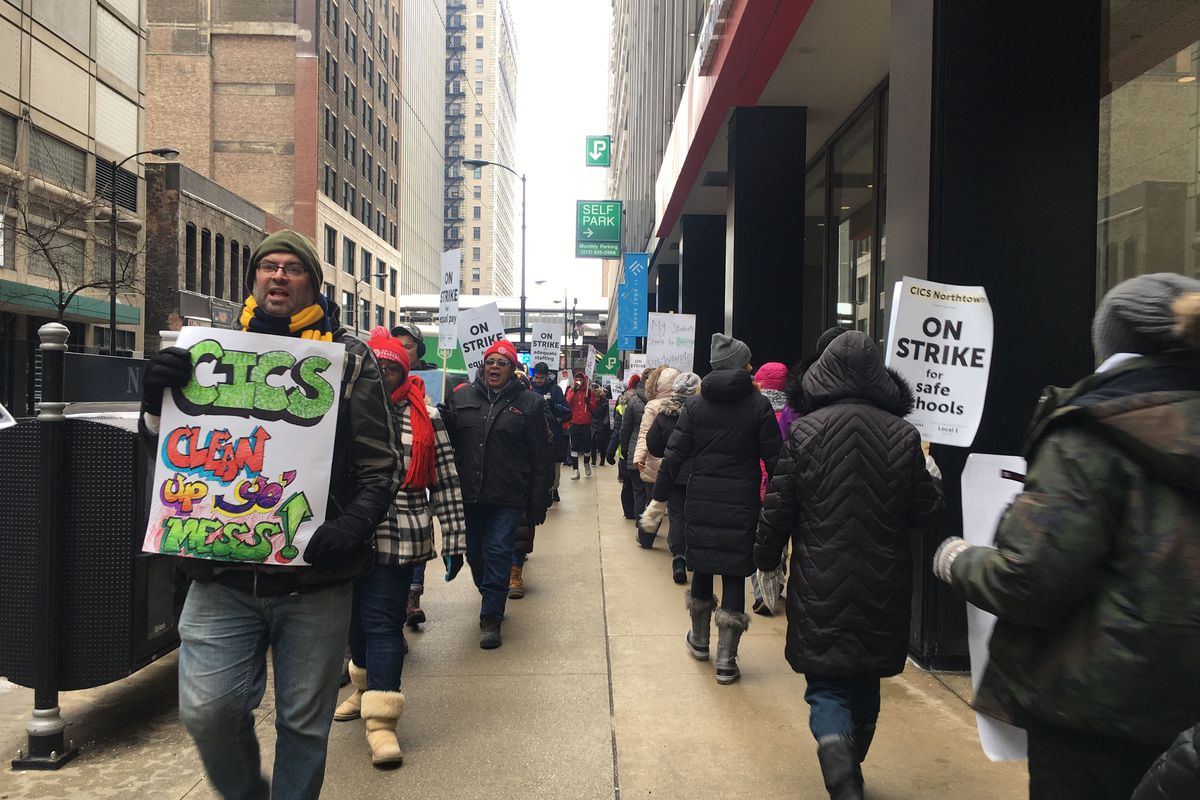 Striking Chicago International Charter School teachers and supporters march in front of CICS's Chicago  corporate offices Monday, Feb. 11, 2019.
