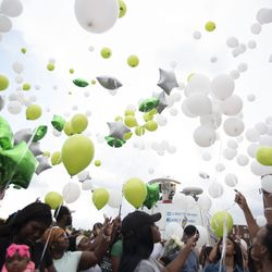 Balloons are released at the vigil.   Colin Boyle/Sun-Times