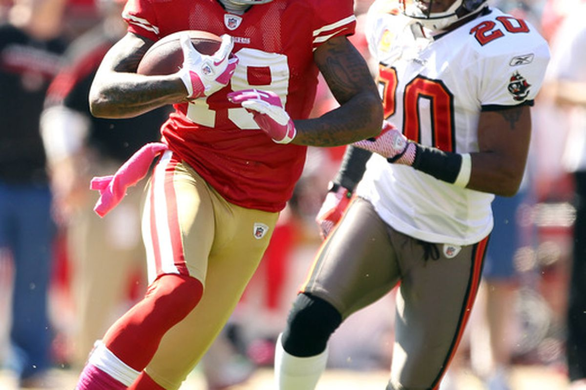 SAN FRANCISCO, CA - OCTOBER 09:   Ted Ginn #19 of the San Francisco 49ers tries to outrun  Ronde Barber #20 of the Tampa Bay Buccaneers at Candlestick Park on October 9, 2011 in San Francisco, California.  (Photo by Ezra Shaw/Getty Images)
