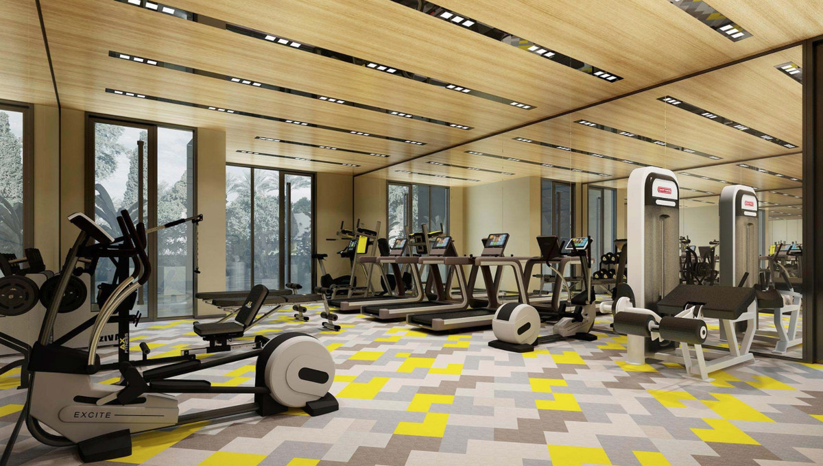 A gym with wood ceilings and patterned floors.