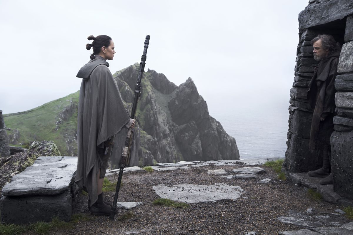 Daisy Ridley as Rey and Mark Hamill as Luke Skywalker in Star Wars: The Last Jedi