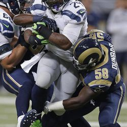 Seattle Seahawks running back Marshawn Lynch (24) is tackled by St. Louis Rams outside linebacker Jo-Lonn Dunbar (58) during the first half of an NFL football game Sunday, Sept. 30, 2012, in St. Louis.