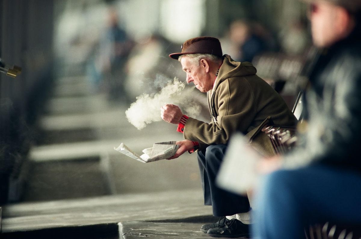 A railbird studies the Racing Form at Hawthorne Race Course in 1996.