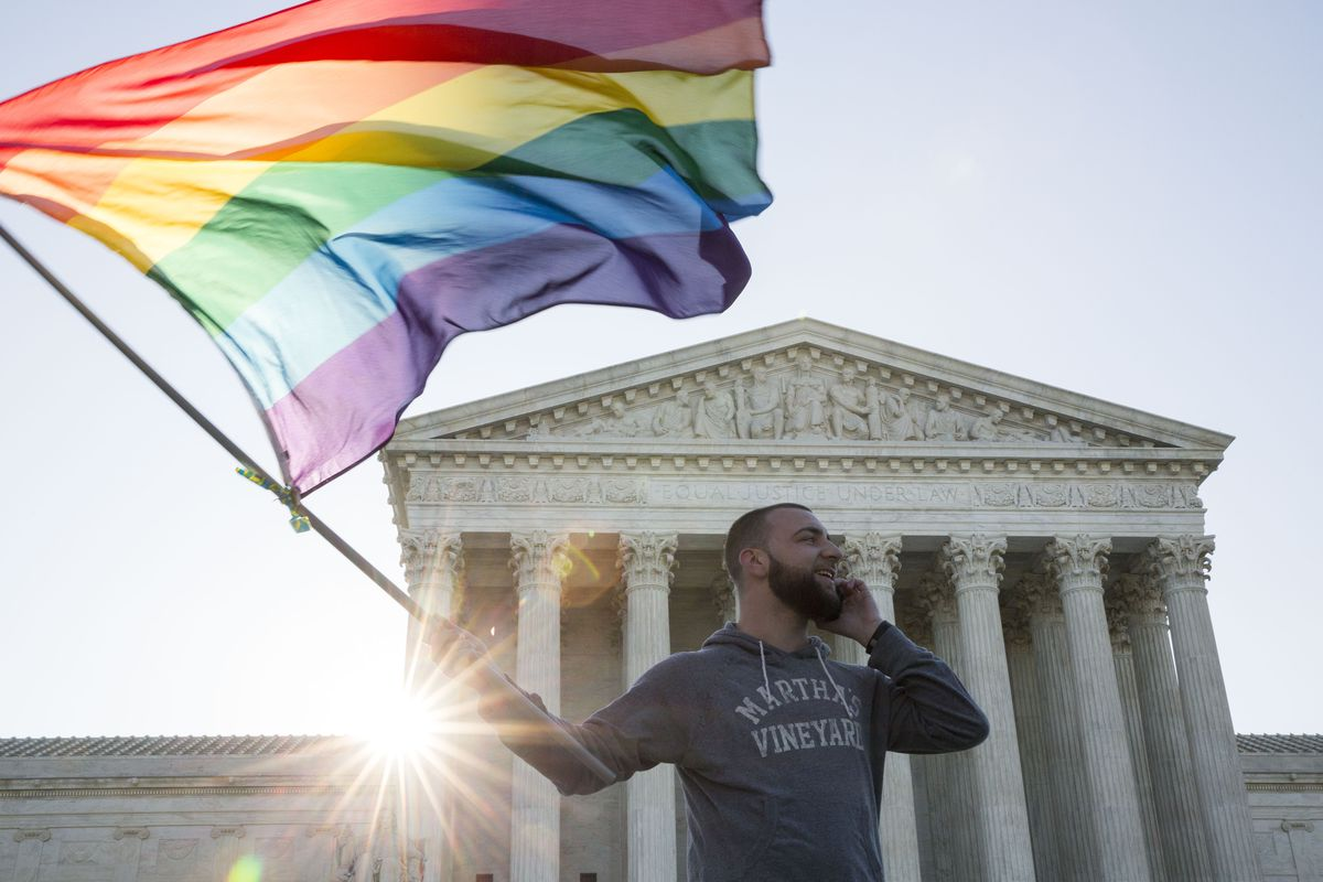 An LGBTQ protester in front of the Supreme Court.