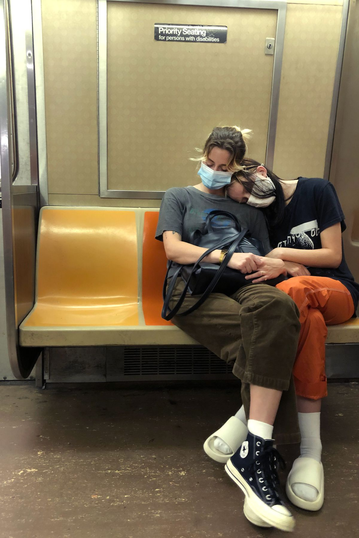 A couple rests on an A train, Aug. 19, 2020.
