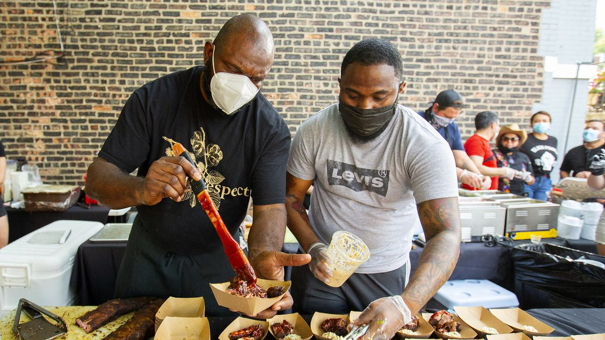 Two chefs serving food.