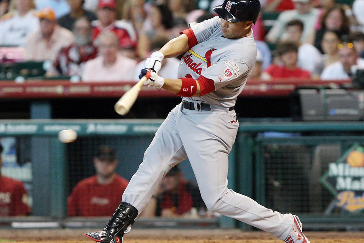 May 06, 2012; Houston, TX, USA; St. Louis Cardinals outfielder Carlos Beltran (3) gets a single in the sixth inning against the Houston Astros at Minute Maid Park. Mandatory Credit: Troy Taormina-US PRESSWIRE