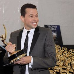 Actor Jon Cryer, winner of Outstanding Lead Actor in a Comedy Series, poses backstage at the 64th Primetime Emmy Awards at the Nokia Theatre on Sunday, Sept. 23, 2012, in Los Angeles.