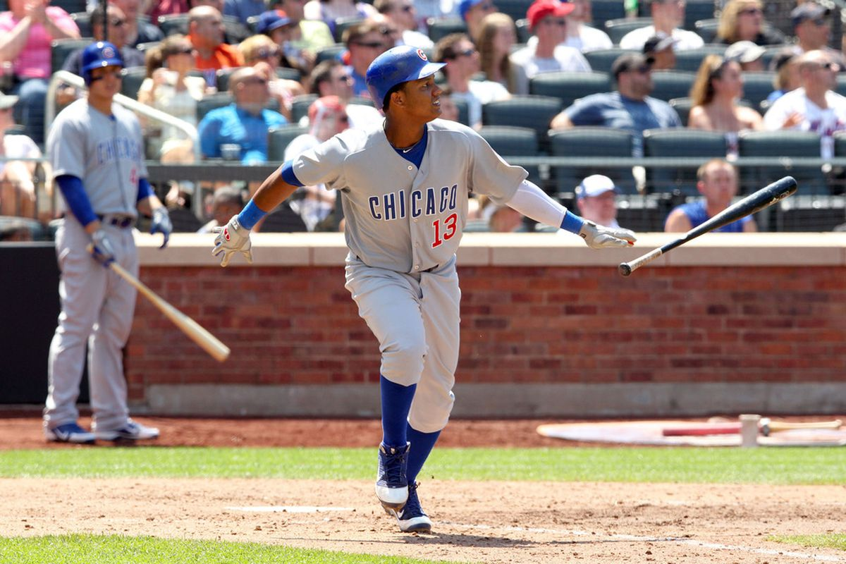 July 8, 2012; New York, NY, USA; Chicago Cubs batter Starlin Castro (13) watches his three-run home run during the seventh inning of a game against the New York Mets at Citi Field. Mandatory Credit: Brad Penner-US PRESSWIRE