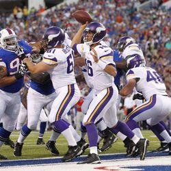 Aug 16, 2013; Orchard Park, NY, USA; Minnesota Vikings quarterback Matt Cassel (16) passes from the end zone against the Buffalo Bills at Ralph Wilson Stadium.